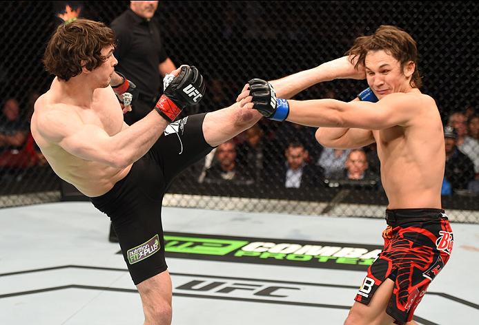 Olivier Aubin-Mercier kicks <a href='../fighter/David-Michaud'>David Michaud</a> in their bout during UFC 186 on 4/25/15 in Montreal, Quebec, Canada. (Photo by Josh Hedges/Zuffa LLC)