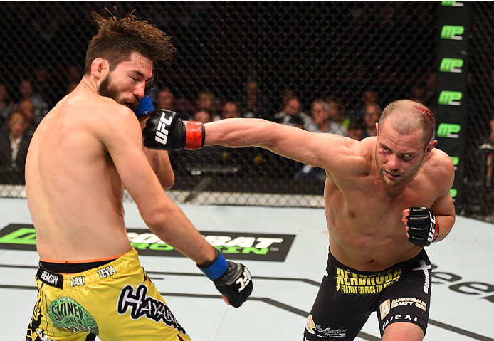 Chad Laprise punches Bryan Barberena in their lightweight bout during the UFC 186 event on April 25, 2015 in Montreal, Quebec, Canada. (Photo by Josh Hedges/Zuffa LLC)