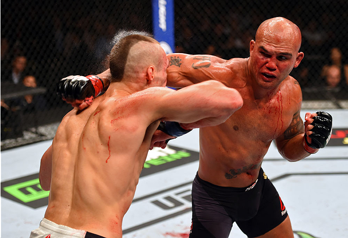 <a href='../fighter/Robbie-Lawler'>Robbie Lawler</a> punches <a href='../fighter/Rory-MacDonald'>Rory MacDonald</a> during their welterweight title fight at UFC 189