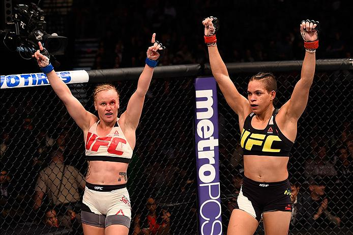LAS VEGAS, NV - MARCH 05: (L) <a href='../fighter/Valentina-Shevchenko'>Valentina Shevchenko</a> and Amanda Nunes raise their hands after their bantamweight bout during the UFC 196 event inside MGM Grand Garden Arena on March 5, 2016 in Las Vegas, Nevada. (Photo by Josh Hedges/Zuffa LLC/Zuffa LLC via Getty Images)