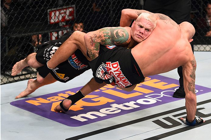 Joe Riggs takes down Ben Saunders in their welterweight fight during the UFC Fight Night event at the U.S. Airways Center on December 13, 2014 in Phoenix, Arizona. (Photo by Josh Hedges/Zuffa LLC)