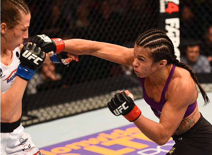 (R-L) Claudia Gadelha of Brazil punches Joanna Jedrzejczyk of Poland in their women's strawweight fight during the UFC Fight Night event on December 13, 2014 in Phoenix, AZ. (Photo by Josh Hedges/Zuffa LLC)