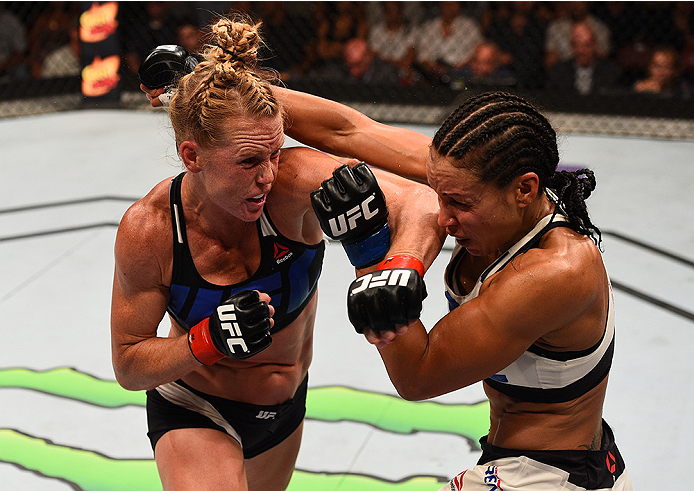 Holly Holm punches Marion Reneau in their women's bantamweight bout during the UFC event at the Valley View Casino Center on July 15, 2015 in San Diego, Calif. (Jeff Bottari/Zuffa LLC)