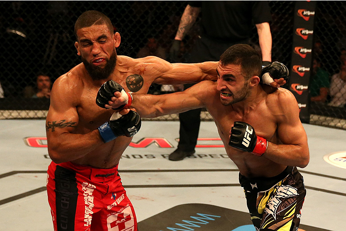 (R-L) Alan Omer connects with a right to the face of Jim Alers during their bout during UFC Fight Night at du Arena on April 11, 2014 in Abu Dhabi, United Arab Emirates. (Photo by Warren Little/Zuffa LLC)