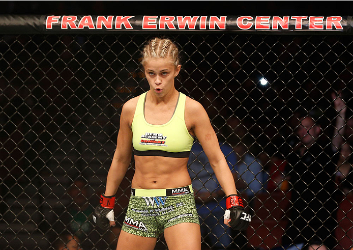 AUSTIN, TX - NOVEMBER 22: Paige VanZant stands in the Octagon before her women's bantamweight bout against Kailin Curran during the UFC Fight Night event at The Frank Erwin Center on November 22, 2014 in Austin, Texas. (Photo by Josh Hedges/Zuffa LLC/Zuffa LLC via Getty Images)