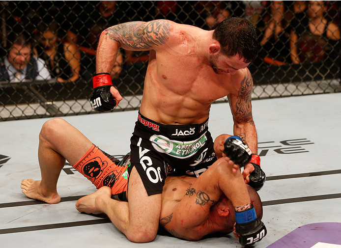 Edgar (top) tries to finish Swanson via ground-and-pound