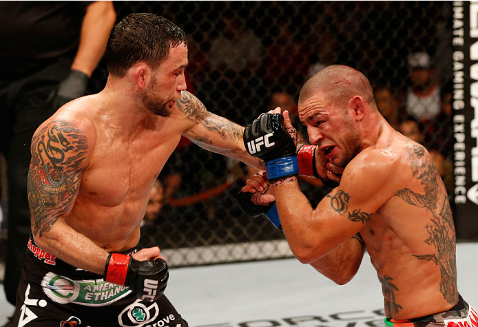 AUSTIN, TX - NOVEMBER 22: (L-R) Frankie Edgar punches Cub Swanson in their featherweight bout during the UFC Fight Night event at The Frank Erwin Center on November 22, 2014 in Austin, Texas. (Photo by Josh Hedges/Zuffa LLC/Zuffa LLC via Getty Images)