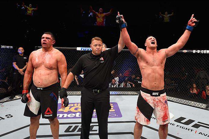 LAS VEGAS, NV - MAY 29: <a href='../fighter/adam-milstead'>Adam Milstead</a> (right) reacts to his victory over <a href='../fighter/chris-de-la-rocha'>Chris De La Rocha</a> (left) in their heavyweight bout during the <a href='../event/UFC-Silva-vs-Irvin'>UFC Fight Night </a>event inside the Mandalay Bay Events Center on May 29, 2016 in Las Vegas, Nevada. (Photo by Josh Hedges/Zuffa LLC/Zuffa LLC via Getty Images)