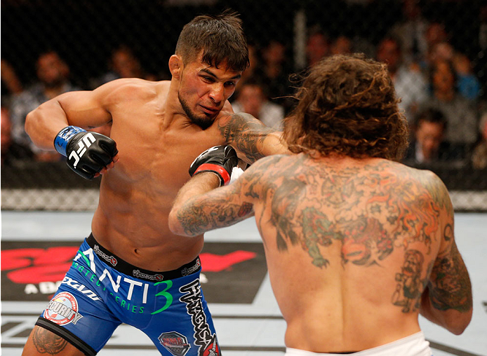 (L-R) Dennis Bermudez punches Clay Guida in their featherweight bout during the UFC Fight Night event at the SAP Center on July 26, 2014 in San Jose, CA. (Photo by Jeff Bottari/Zuffa LLC)