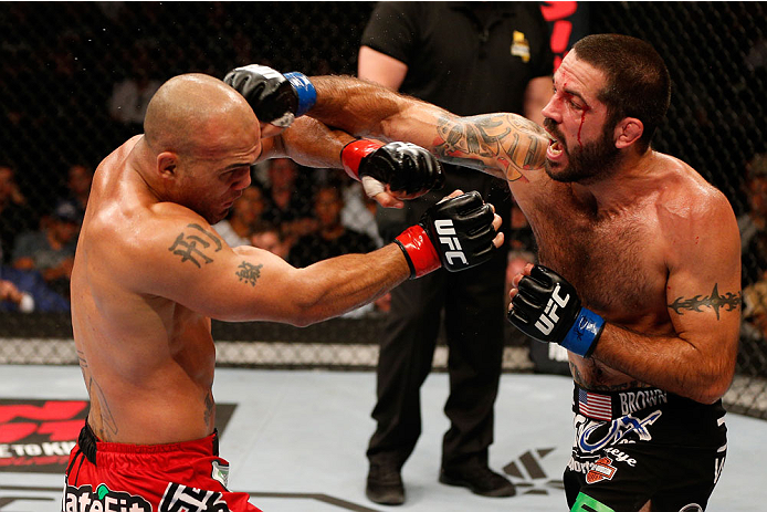 (R-L) Matt Brown punches Robbie Lawler in their welterweight bout during the UFC Fight Night event at the SAP Center on July 26, 2014 in San Jose, CA. (Photo by Jeff Bottari/Zuffa LLC)