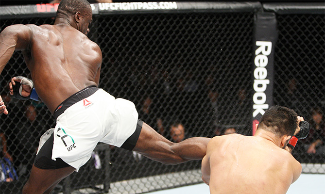 Uriah Hall of Jamaica lands a back kick to drop his opponent, Gegard Mousaasi of Iran in their middleweight bout during the UFC event at the Saitama Super Arena on September 27, 2015 in Saitama, Japan. (Photo by Mitch Viquez/Zuffa LLC)