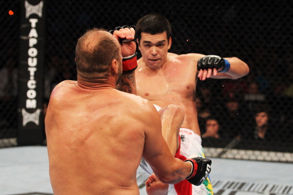 TORONTO, ON - APRIL 30: Lyoto Machida (back) kicks Randy Couture to win by knockout in the second round of their Light Heavyweight bout at UFC 129 in the Rogers Centre on April 30, 2011 in Toronto, Ontario. (Photo by Al Bello/Zuffa LLC/Zuffa LLC via Getty Images)
