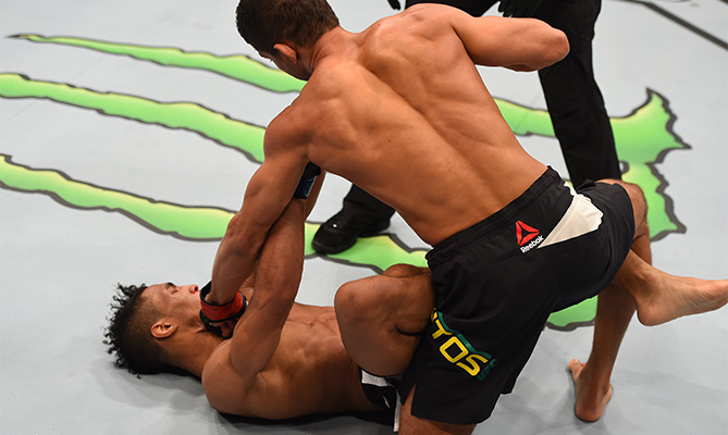 (R-L) Leonardo Santos of Brazil punches Kevin Lee in their lightweight bout during the UFC 194 event inside MGM Grand Garden Arena on December 12, 2015 in Las Vegas, Nevada. (Photo by Josh Hedges/Zuffa LLC)