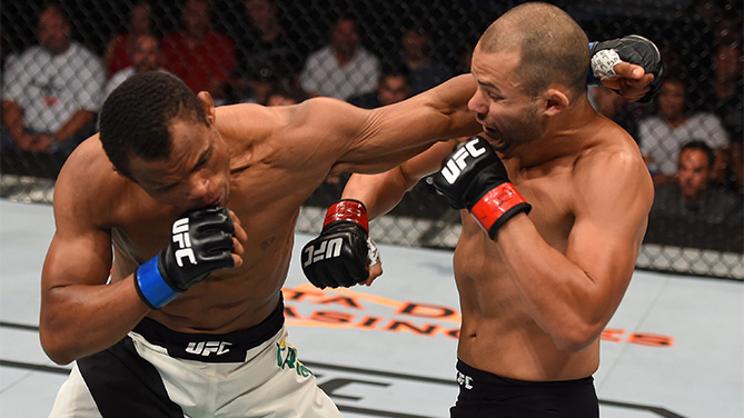(L-R) Francisco Trinaldo of Brazil punches Chad Laprise in their lightweight bout during the UFC event at the SaskTel Centre on August 23, 2015 in Saskatoon, Saskatchewan, Canada. (Photo by Jeff Bottari/Zuffa LLC)
