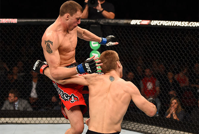 (L-R) James Vick knees Jake Matthews in their lightweight bout during the UFC Fight Night event at the Adelaide Entertainment Centre on May 10, 2015 in Adelaide, Australia. (Photo by Josh Hedges/Zuffa LLC)
