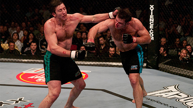 LAS VEGAS, NV - APRIL 09: (R-L) Forrest Griffin and Stephan Bonnar trade punches during the Light Heavyweight Final bout during the live Ultimate Fighter Season Finale at the Cox Pavilion on April 9, 2005 in Las Vegas, Nevada. (Photo by Josh Hedges/Zuffa LLC/Zuffa LLC via Getty Images)