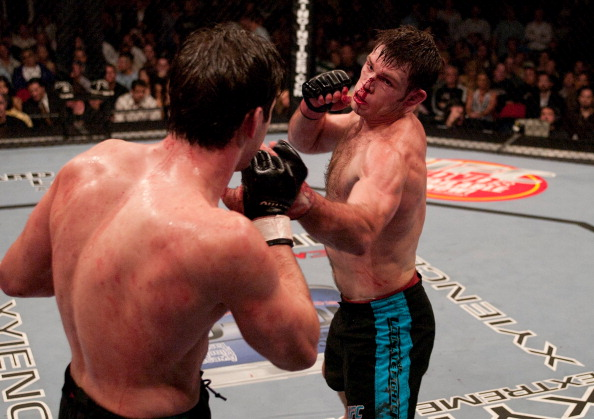 LAS VEGAS, NV - APRIL 09: (R-L) Forrest Griffin punches Stephan Bonnar during the Light Heavyweight Final bout during the live Ultimate Fighter Season Finale at the Cox Pavilion on April 9, 2005 in Las Vegas, Nevada. (Photo by Josh Hedges/Zuffa LLC/Zuffa LLC via Getty Images)