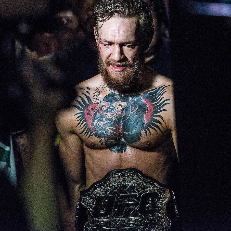 Conor McGregor makes his walk to the back after capturing the UFC interim featherweight title against Chad Mendes at UFC 189.