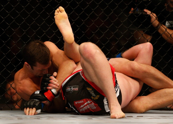 BALTIMORE, MD - APRIL 26: (L-R) Luke Rockhold secures a kimura submission against Tim Boetsch in their middleweight bout during the UFC 172 event at the Baltimore Arena on April 26, 2014 in Baltimore, Maryland. (Photo by Josh Hedges/Zuffa LLC/Zuffa LLC via Getty Images)