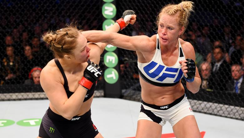 Holly Holm punches Ronda Rousey in their UFC women's bantamweight championship bout during the UFC 193 event at Etihad Stadium on November 15, 2015 in Melbourne, Australia.