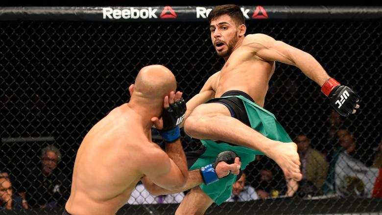 PHOENIX, AZ - JANUARY 15: (R-L) Yair Rodriguez of Mexico kicks BJ Penn in their featherweight bout during the UFC Fight Night event inside Talking Stick Resort Arena on January 15, 2017 in Phoenix, Arizona. (Photo by Jeff Bottari/Zuffa LLC/Zuffa LLC via Getty Images)