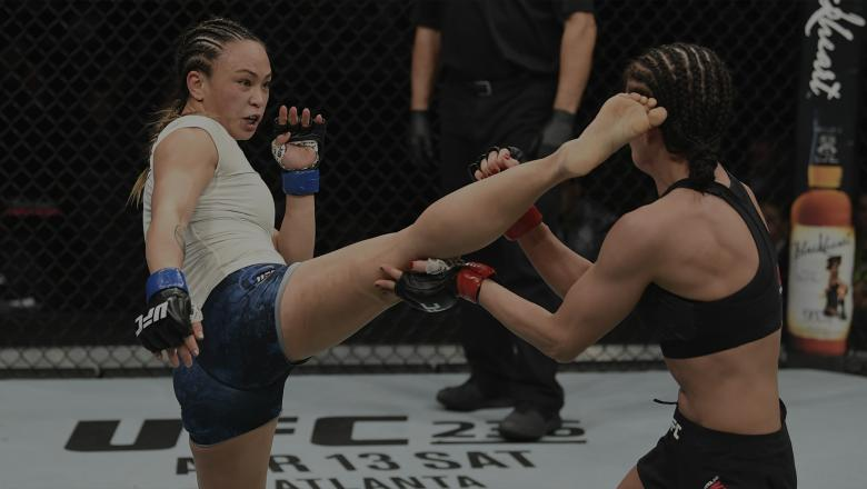 PHILADELPHIA, PA - MARCH 30: (L-R) Michelle Waterson kicks Karolina Kowalkiewicz of Poland in their women's strawweight bout during the UFC Fight Night Event event at Wells Fargo Center on March 30, 2019 in Philadelphia, Pennsylvania. (Photo by Josh Hedges/Zuffa LLC/Zuffa LLC via Getty Images)