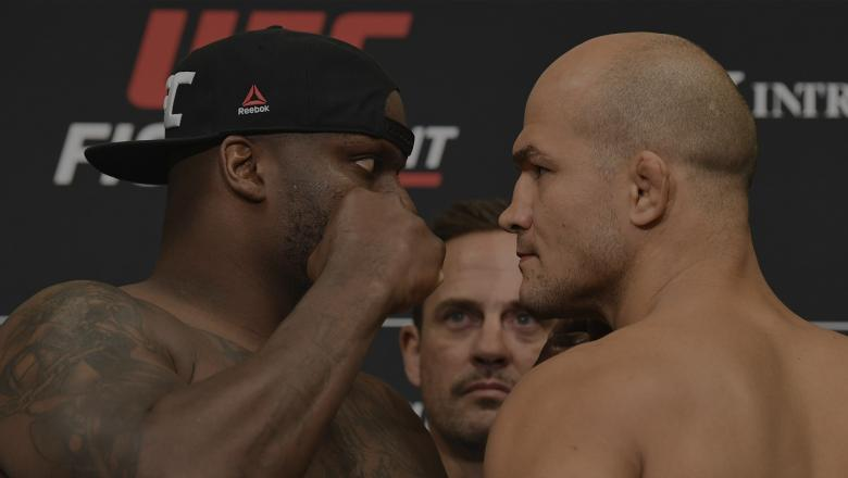 WICHITA, KS - MARCH 08: (L-R) Derrick Lewis and Junior Dos Santos of Brazil face off during the UFC Fight Night weigh-in at the Hyatt Regency Wichita on March 8, 2019 in Wichita, Kansas. (Photo by Josh Hedges/Zuffa LLC/Zuffa LLC via Getty Images)