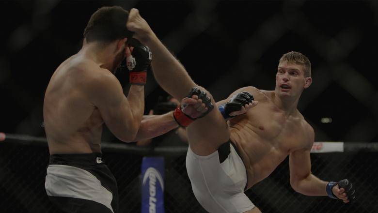 LAS VEGAS, NV - JULY 12: (R-L) Stephen Thompson kicks Jake Ellenberger in their welterweight bout during the Ultimate Fighter Finale inside MGM Grand Garden Arena on July 12, 2015 in Las Vegas, Nevada. (Photo by Mitch Viquez/Zuffa LLC/Zuffa LLC via Getty Images)