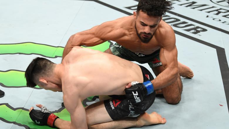 ATLANTA, GA - APRIL 13: (R-L) Khalid Taha of Germany punches Boston Salmon in their bantamweight bout during the UFC 236 event at State Farm Arena on April 13, 2019 in Atlanta, Georgia. (Photo by Josh Hedges/Zuffa LLC/Zuffa LLC via Getty Images)