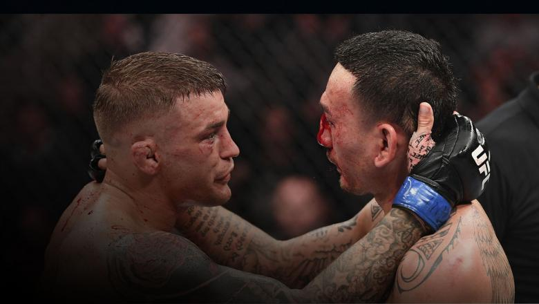 Dustin Poirier and Max Holloway embrace after finishing five rounds in their interim lightweight championship bout during the UFC 236 event at State Farm Arena on April 13, 2019 in Atlanta, Georgia. (Photo by Josh Hedges/Zuffa LLC)