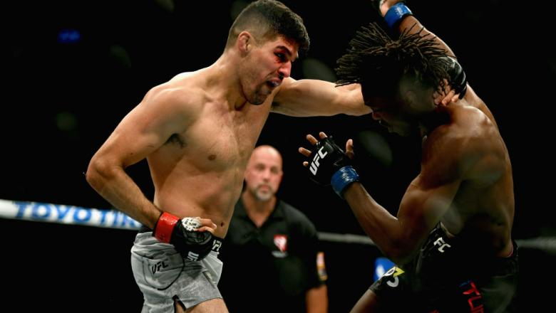 LAS VEGAS, NV - OCTOBER 06:  Vicente Luque (L) punches Jalin Turner in their welterweight bout during the UFC 229 event inside T-Mobile Arena on October 6, 2018 in Las Vegas, Nevada.  (Photo by Harry How/Getty Images)