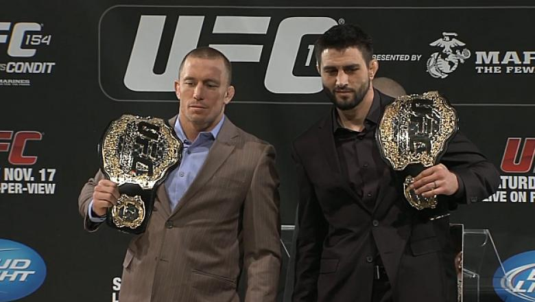 Welterweight Champion Georges St-Pierre stands with his challenger, Interim Welterweight Champion Carlos Condit at the UFC 154 pre fight press conference