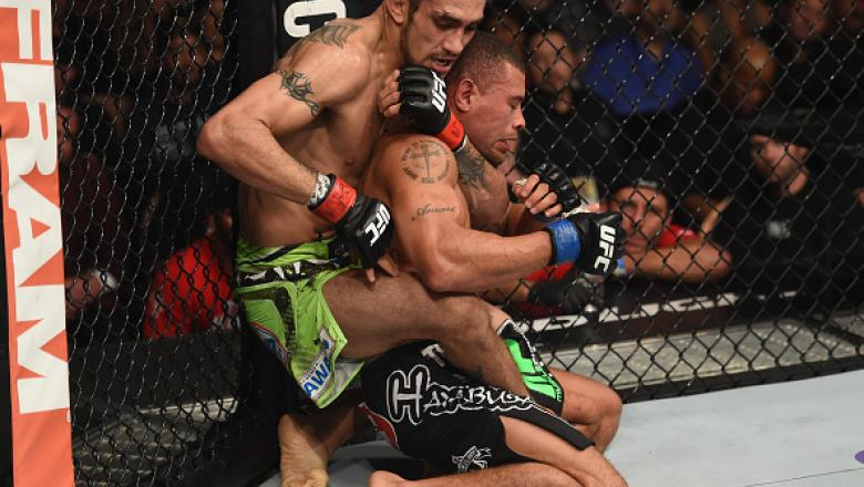 LAS VEGAS, NV - DECEMBER 06:  (L-R) Tony Ferguson attempts to submit Abel Trujillo in their lightweight bout during the UFC 181 event inside the Mandalay Bay Events Center on December 6, 2014 in Las Vegas, Nevada.  (Photo by Robert Laberge/Zuffa LLC/Zuffa