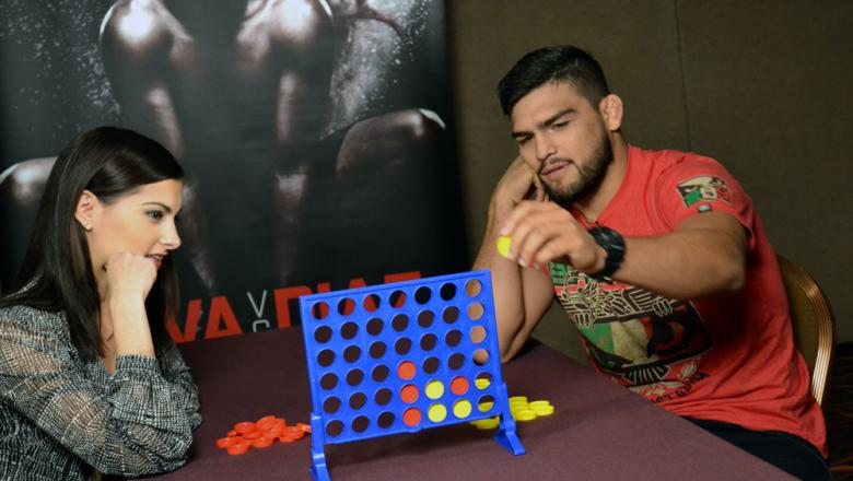 Kelvin Gastelum plays Connect 4 with UFC correspondent Megan Olivi during UFC 183 fight week.