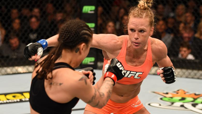 LOS ANGELES, CA - FEBRUARY 28:  (R) Holly Holm punches Raquel Pennington in their women's bantamweight bout during the UFC 184 event at Staples Center on February 28, 2015 in Los Angeles, California.  (Photo by Josh Hedges/Zuffa LLC/Zuffa LLC via Getty Im
