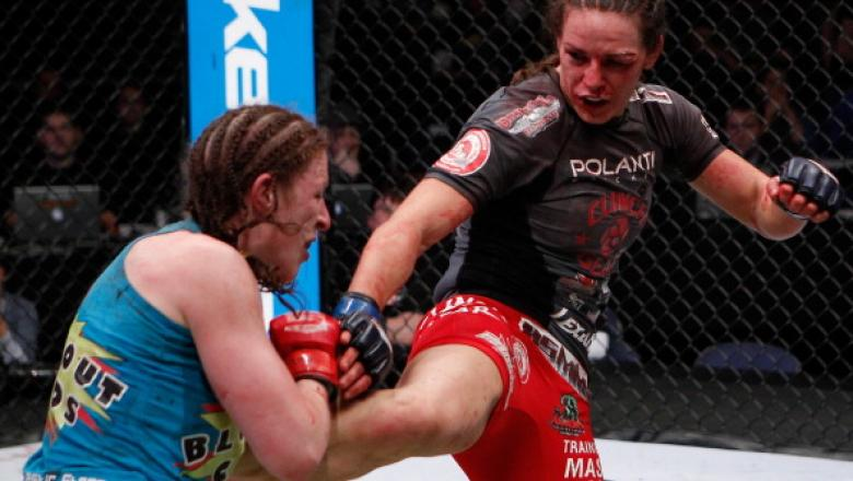 COLUMBUS, OH - MARCH 03:  Alexis Davis (right) kicks Sarah Kaufman (left) during the Strikeforce event at Nationwide Arena on March 3, 2012 in Columbus, Ohio.  (Photo by Esther Lin/Forza LLC/Forza LLC via Getty Images)
