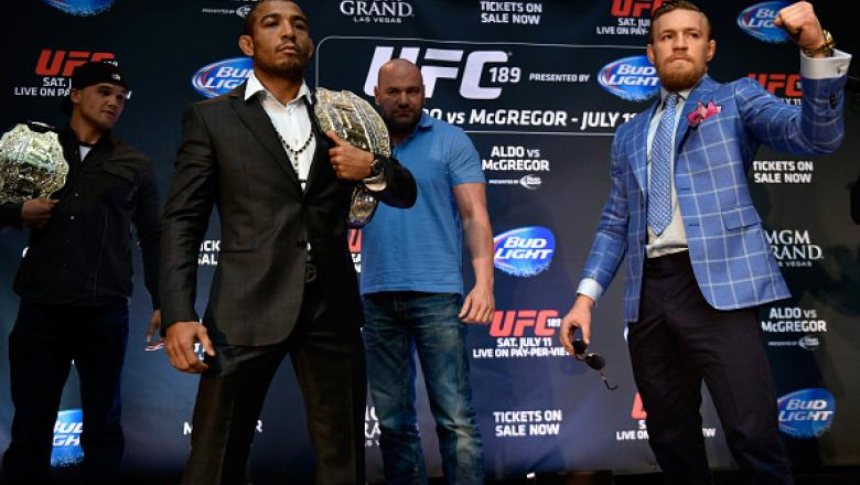 TORONTO, ON - MARCH 27:  UFC Featherweight Champion Jose Aldo (L) and challenger Conor McGregor square off during the UFC 189 World Championship Press Tour press conference at the Eaton Centre on March 27, 2015 in Toronto, Ontario, Canada. (Photo by Jeff