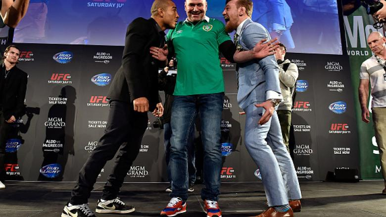 DUBLIN, IRELAND - MARCH 31:  UFC President Dana White (C) separates UFC Featherweight Champion Jose Aldo of Brazil (L) and title challenger Conor 'The Notorious' McGregor of Ireland (R) as they face off during the UFC 189 World Championship Fan Event on M