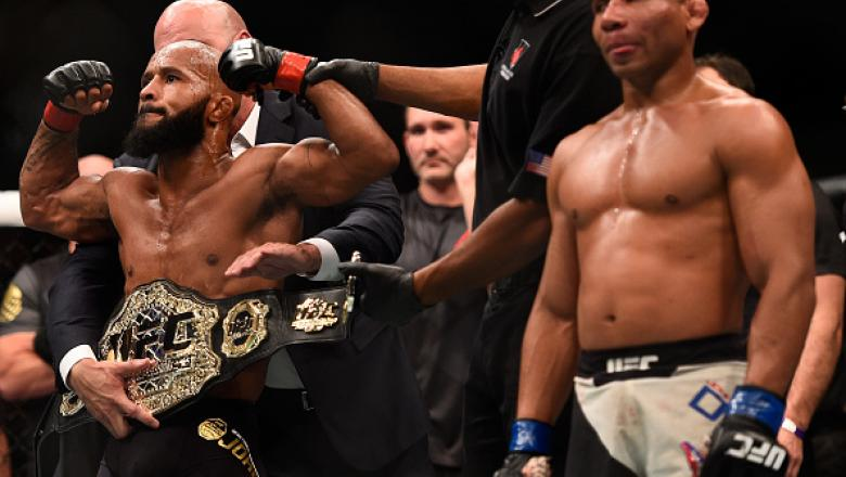 LAS VEGAS, NV - SEPTEMBER 05: Demetrious Johnson (left) reacts to his victory over John Dodson (right) in their flyweight championship bout during the UFC 191 event inside MGM Grand Garden Arena on September 5, 2015 in Las Vegas, Nevada.  (Photo by Jeff B