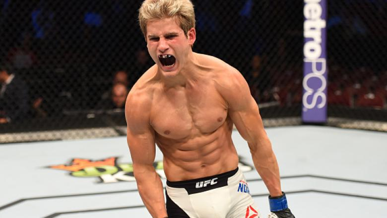 HOUSTON, TX - OCTOBER 03:  Sage Northcutt celebrates his victory over Francisco Trevino in their lightweight bout during the UFC 192 event at the Toyota Center on October 3, 2015 in Houston, Texas. (Photo by Josh Hedges/Zuffa LLC/Zuffa LLC via Getty Image