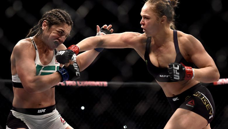RIO DE JANEIRO, BRAZIL - AUGUST 01:  Ronda Rousey of the United States punches Bethe Correia of Brazil in their bantamweight title fight during the UFC 190 Rousey v Correia at HSBC Arena on August 1, 2015 in Rio de Janeiro, Brazil.  (Photo by Buda Mendes/
