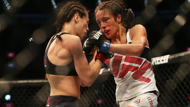 MELBOURNE, AUSTRALIA - NOVEMBER 15:  Joanna Jedrzejczyk of Poland (L) and Valerie Letourneau of Canada compete in their UFC women's strawweight championship bout during the UFC 193 event at Etihad Stadium on November 15, 2015 in Melbourne, Australia.  (Ph