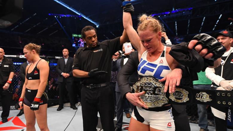 MELBOURNE, AUSTRALIA - NOVEMBER 15:  Holly Holm of the United States celebrates after her knockout victory over Ronda Rousey of the United States in their UFC women's bantamweight championship bout during the UFC 193 event at Etihad Stadium on November 15