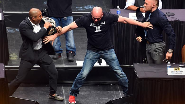 LAS VEGAS, NEVADA - SEPTEMBER 04:  UFC President Dana White (C) separates UFC featherweight champion Jose Aldo (L) and UFC interim featherweight champion Conor McGregor (R) during the UFC's Go Big launch event inside MGM Grand Garden Arena on September 4,