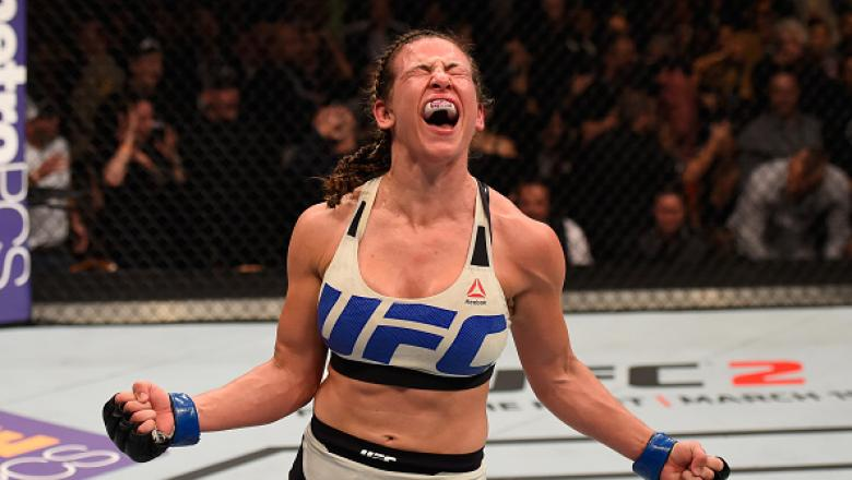 LAS VEGAS, NV - MARCH 05: Miesha Tate reacts after her submission victory over Holly Holm in their UFC women's bantamweight championship bout during the UFC 196 event inside MGM Grand Garden Arena on March 5, 2016 in Las Vegas, Nevada.  (Photo by Josh Hed