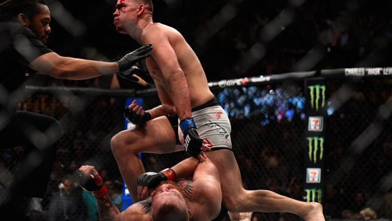 LAS VEGAS, NV - MARCH 05:  Nate Diaz (top) reacts after defeating Conor McGregor of Ireland during the UFC 196 event inside MGM Grand Garden Arena on March 5, 2016 in Las Vegas, Nevada.  (Photo by Jeff Bottari/Zuffa LLC/Zuffa LLC via Getty Images)