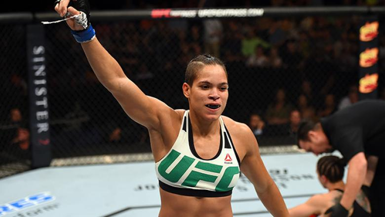 NASHVILLE, TN - AUGUST 08:  (L-R) Amanda Nunes of Brazil celebrates after defeating Sara McMann in their women's bantamweight bout during the UFC Fight Night event at Bridgestone Arena on August 8, 2015 in Nashville, Tennessee.  (Photo by Josh Hedges/Zuff