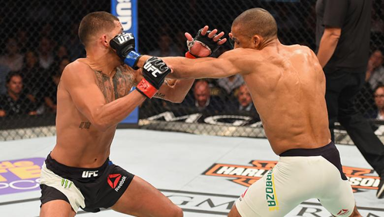 LAS VEGAS, NV - APRIL 23: (R-L) Edson Barboza punches Anthony Pettis in their lightweight bout during the UFC 197 event inside MGM Grand Garden Arena on April 23, 2016 in Las Vegas, Nevada. (Photo by Josh Hedges/Zuffa LLC/Zuffa LLC via Getty Images)