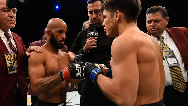 LAS VEGAS, NV - APRIL 23:  (R-L) Demetrious Johnson and Henry Cejudo touch gloves before their flyweight championship bout during the UFC 197 event inside MGM Grand Garden Arena on April 23, 2016 in Las Vegas, Nevada.  (Photo by Josh Hedges/Zuffa LLC/Zuff