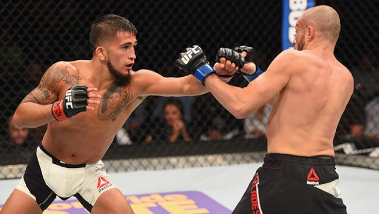 LAS VEGAS, NV - APRIL 23: (L-R) Sergio Pettis punches Chris Kelades in their flyweight bout during the UFC 197 event inside MGM Grand Garden Arena on April 23, 2016 in Las Vegas, Nevada. (Photo by Josh Hedges/Zuffa LLC/Zuffa LLC via Getty Images)